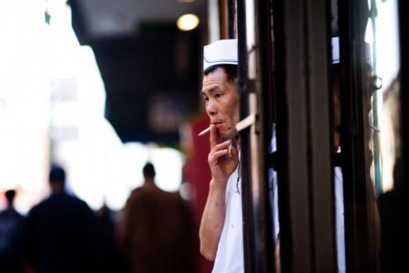 Restaurant cook taking cigarette break in doorway