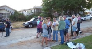 Neighbors and reporters at the scene. Credit OB Rag