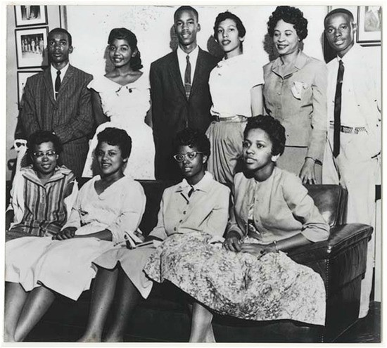 The Little Rock Nine: Ernest Green, Thelma Mothershed, Elizabeth Eckford, Terrace Roberts, Carlotta Walls, Gloria Ray, Jefferson Thomas, Melba Pattillo, and Minnijean Brown with Daily Bates (standing, second from right) Credit Library of Congress NAACP/Cecil Layne, photographer