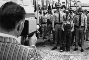 "Arrest of Lori ""Sierra"" Knight, May 4, 1972 by Fred Lonidier."
