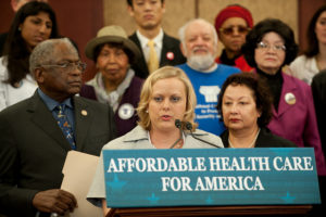 Felicia Willems at podium giving thanks for Affordable Care Act