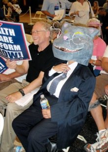"Susan Davis town hall participant in corporate ""fat cat"" costume"