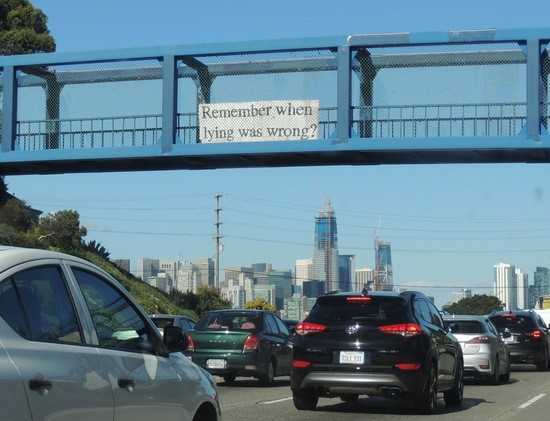 "Banner on freeway overpass ""Remember when lying was wrong"""