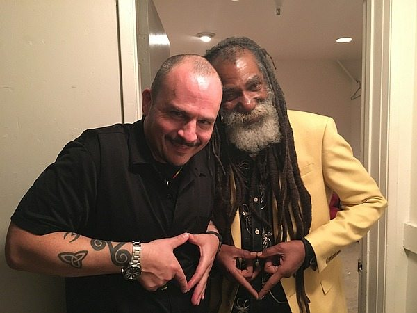 "Stephen Cooper and Don Carlos making ""heart"" hand signs"