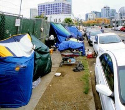 Tents set up along sidewalk downtown San Diego