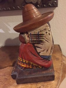 Carved seated figure with sombrero and serape