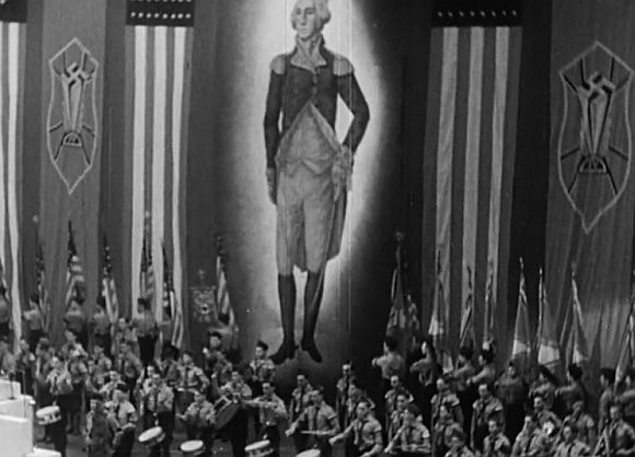 American Nazi rally stage backdrop with George Washington flanked by flags and swastikas