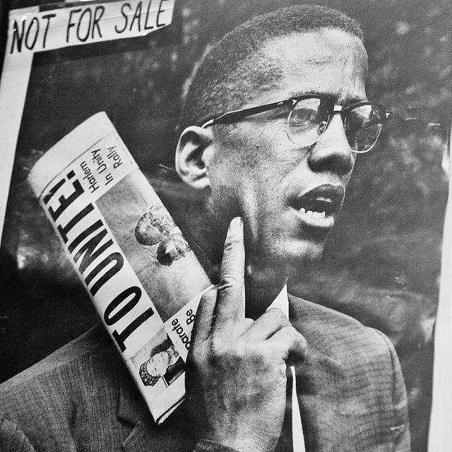"Photo of Malcolm X poster labeled ""NOT FOR SALE"""