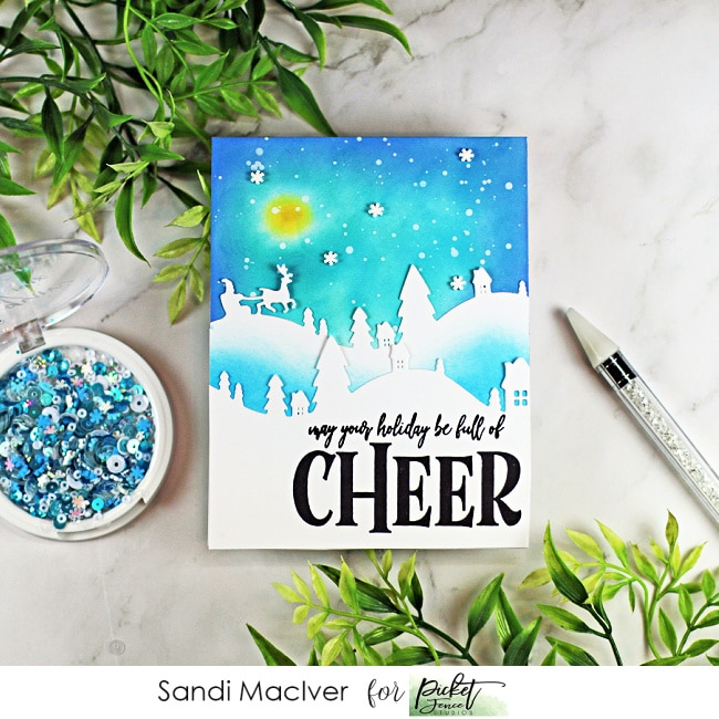handmade christmas card with santa and reindeer with a blue sky and a full moon made with cardmaking products from Picket Fence STudios