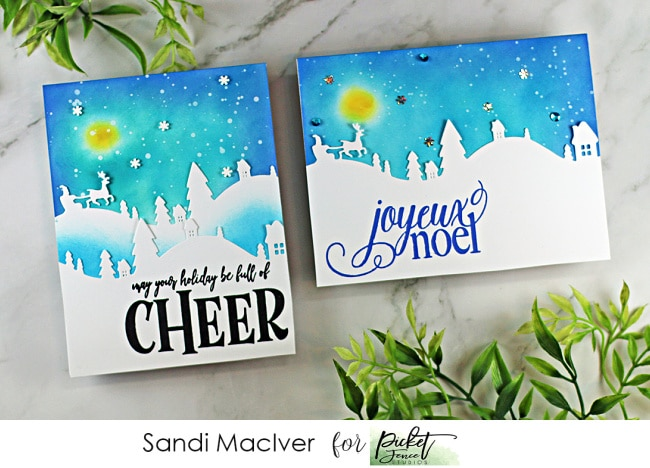 two cards with die cut winter scene and a moon and blue sky background with products from Picket Fence STudios