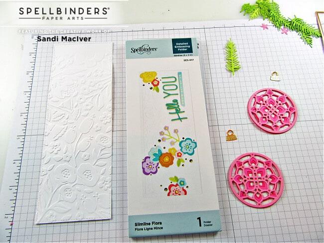 using the Spellbinders Slimline Flora Embossing Folder to create the card background
