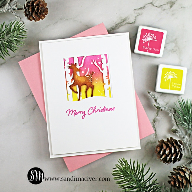 pink and white handmade christmas card with a deer in the forest die cuts from Hero arts