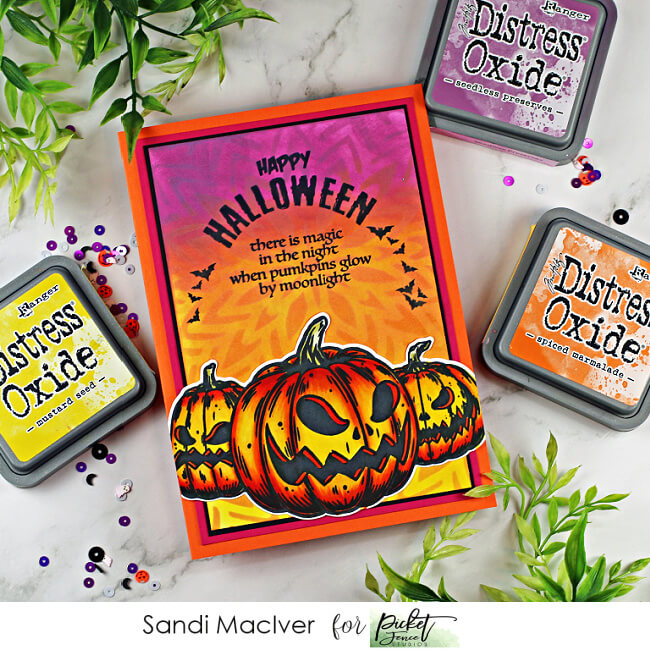 spooky handmade card with jack-o-lanters on a blended distress oxide ink background