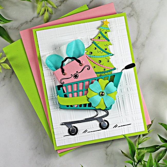 handmade greeting card with a shopping cart, tree and gift back using cardmaking dies from Spellbinders