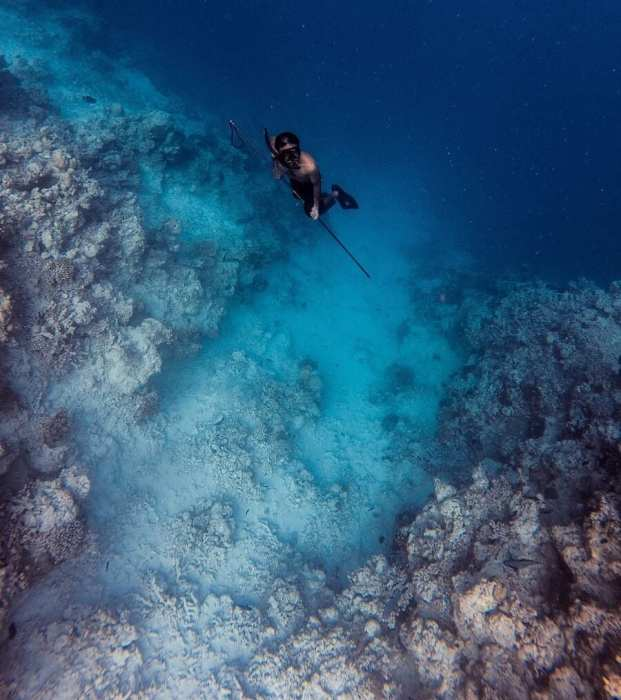 Blue ocean with spearfisherman-Unusual things to do in Phuket