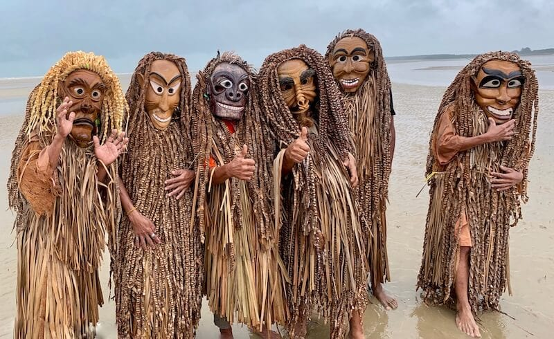 Mah Meri men on the beach in wooden masks. One of the best festivals of malaysia