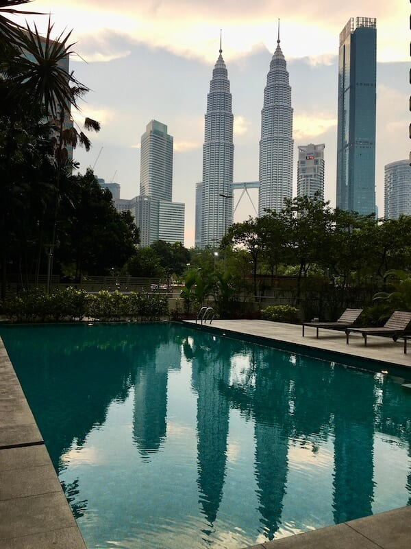KL Petronas Towers reflected in a pool