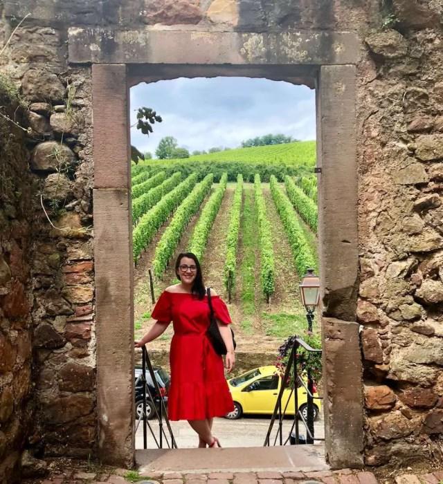 brunette in red dress in vineyard: living in strasbourg