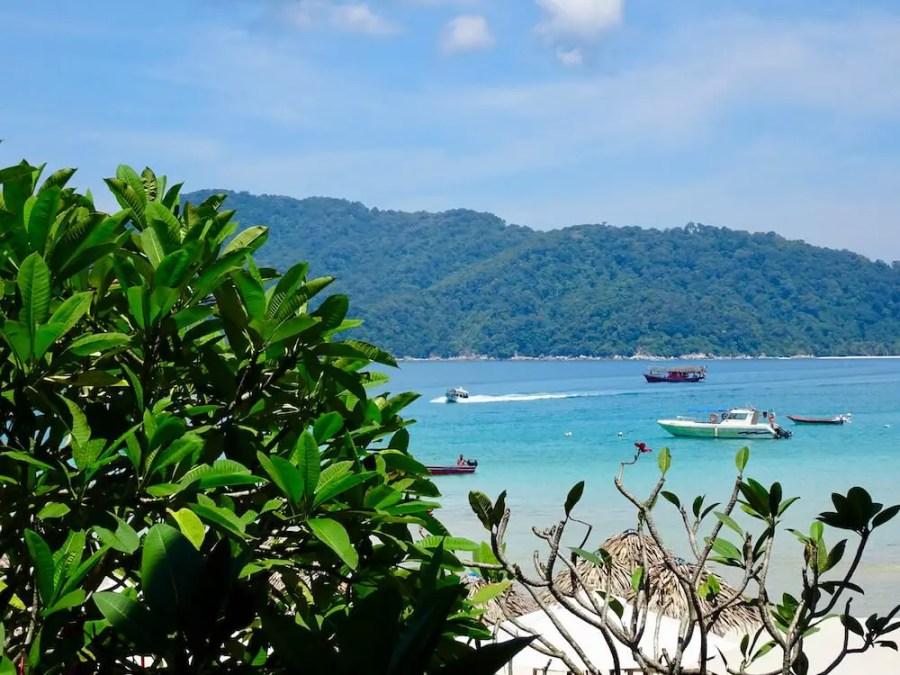 perhentian landscape blue water, gree tree, boat: short getaway in Malaysia