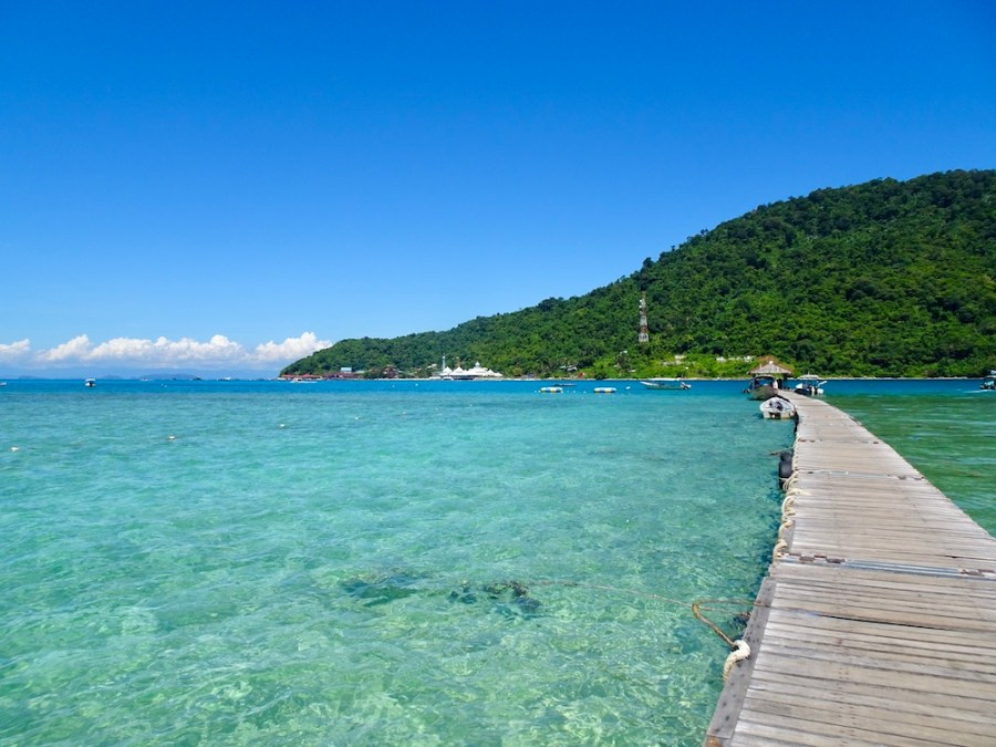 wooden pier with clear blue water