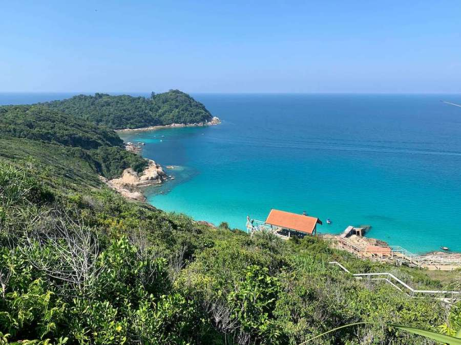 perhentian view: lush green hills, turquoise water