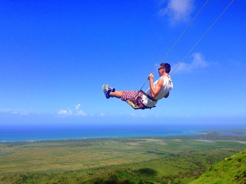 Chris on a swing high over the Dominican Republic landscape. Reasons to move to another country
