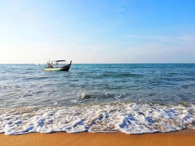 fishing boat near the shore of a beach