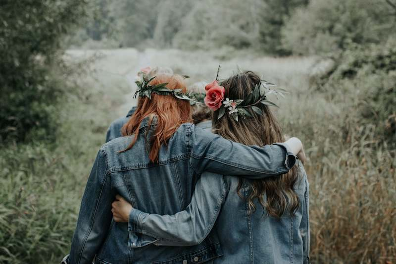 girls with flowers in their hair and jean jackets