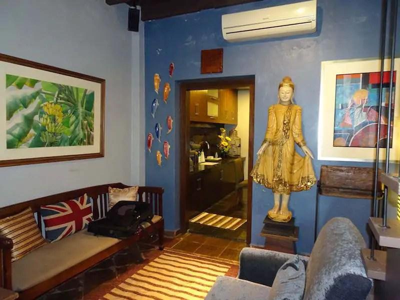 Statute of Buddha and koi fish on the wall