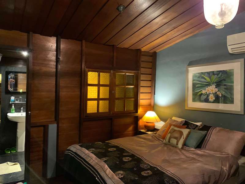 bedroom with wood and blue walls