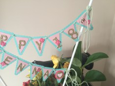Cake Top Banner. Here I have used balloon sticks rather than bamboo or satay sticks. Close up right