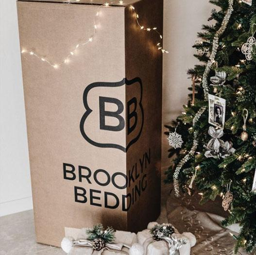 bed-in-box-next-to-christmas-tree