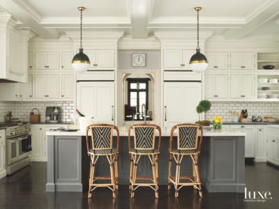 French Bistro Kitchen With Subway Tile Seated Island And Pendant Lighting Luxe Interiors Design