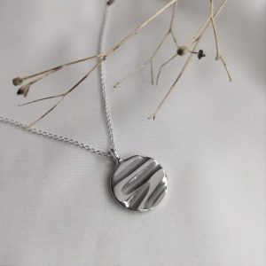 Silver textured disc necklace