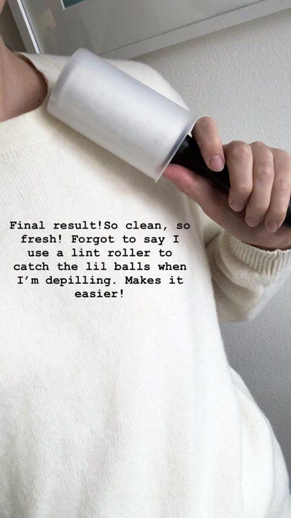 Vit stickade tröja där noppborttagning och fläckborttagning har gjorts