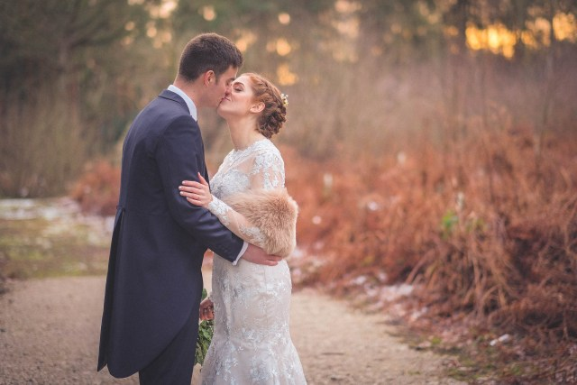 Wirral wedding photographer - Bride and groom kissing at Cheshire venue