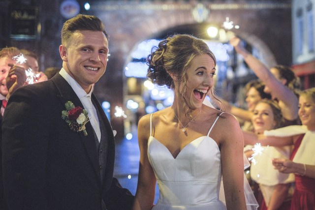 Bride and groom enjoying sparklers at Chester wedding