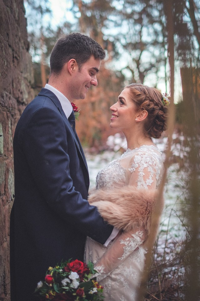 Wedding photography with bride and groom in front of castle in Cheshire