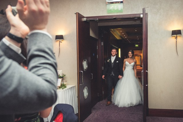 Bride and groom entering function room at Chester Grosvenor