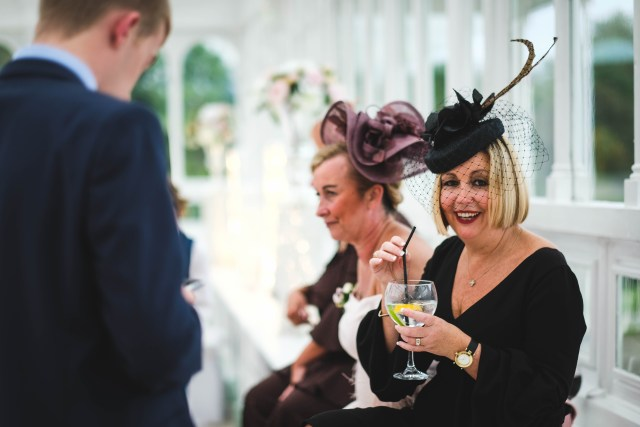 Wedding guest with gin and tonic