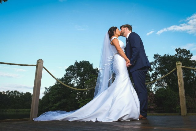 Kissing by the lake - best wedding photographers in Cheshire