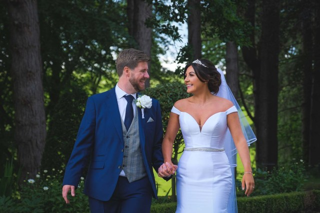 Bride and groom walking together in Cheshire