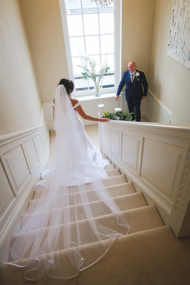 Bridal dress trailing on the stairs at Cheshire wedding