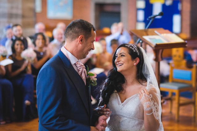 Bride and groom happily married at Holy Trinity Church
