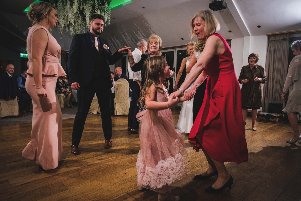 Wedding photography during the evening with people on the dance floor