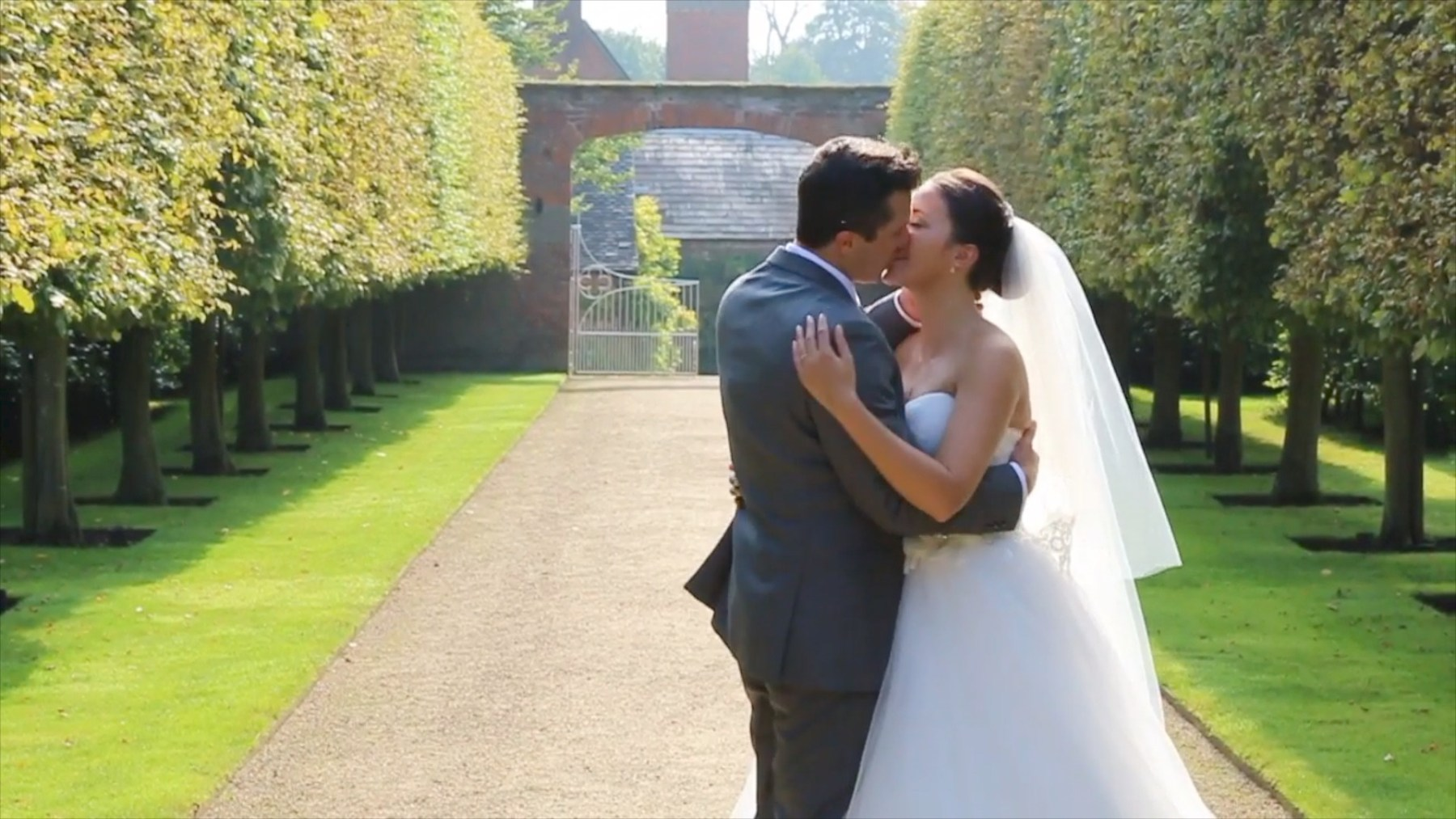 Bride and Groom kissing after wedding at Combermere Abbey in Cheshire