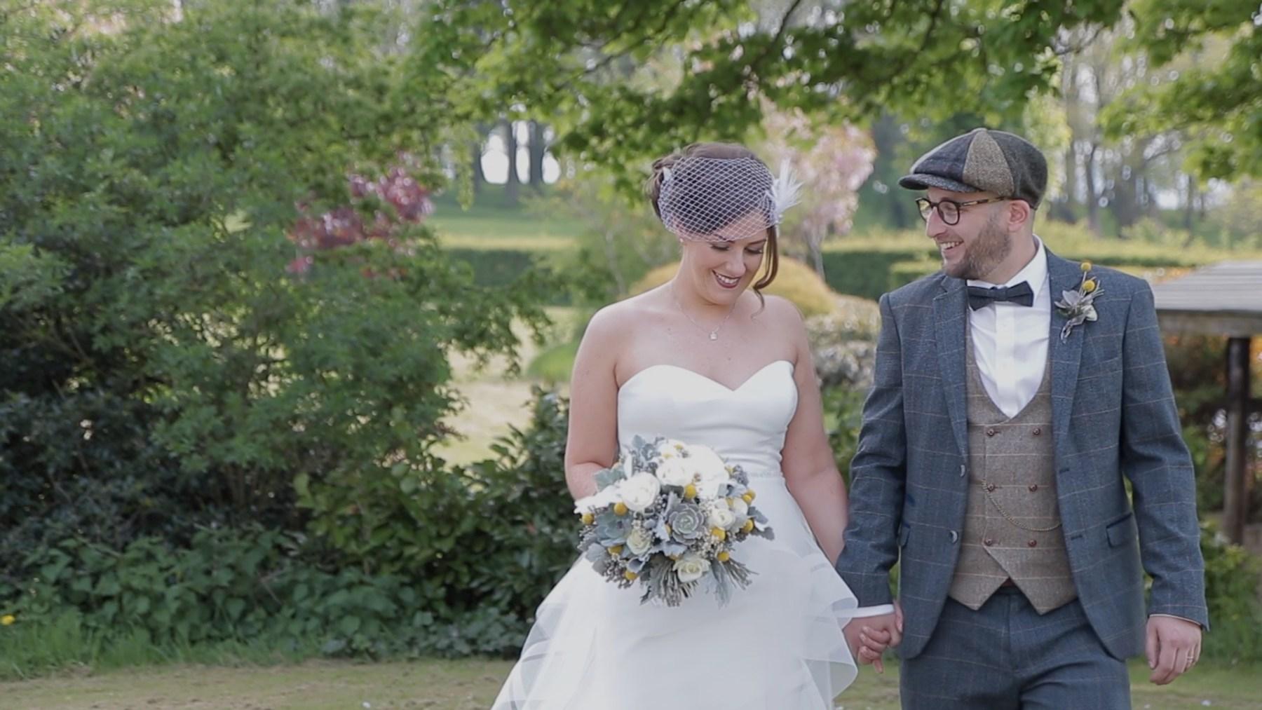 Stirk House Wedding - Bride and groom walking in gardens
