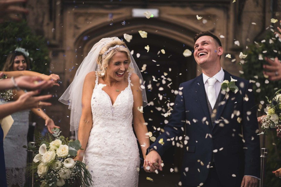 Wedding videographer Wirral - Bride and groom with confetti