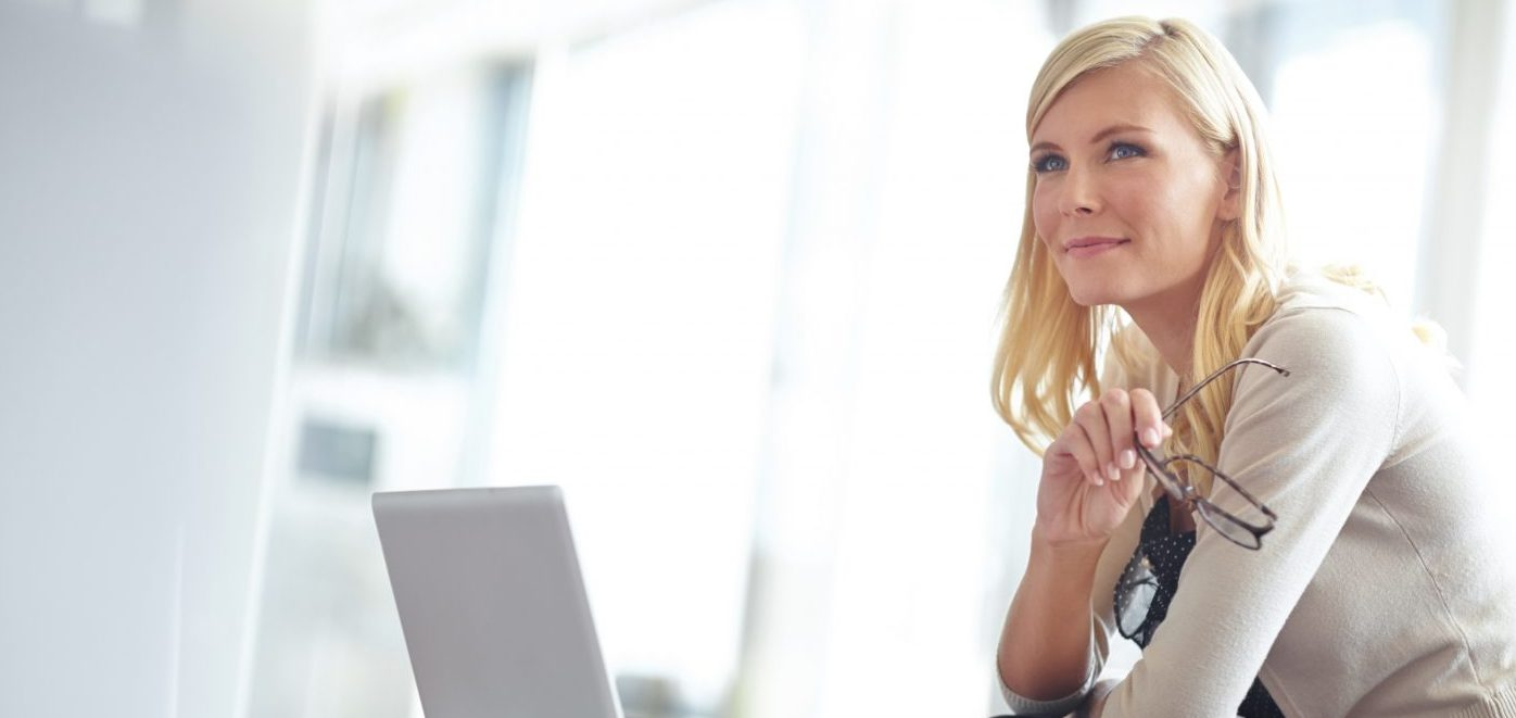 blonde business woman holding glasses and thinking