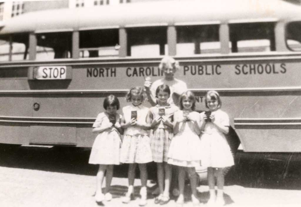 1964/65 Sandy Mush School - girls and teacher in front of school bus